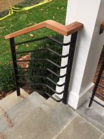 wood cap stair rail with round horizontal bars